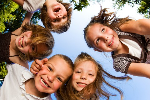 children in group faces looking down. Copy Mobile